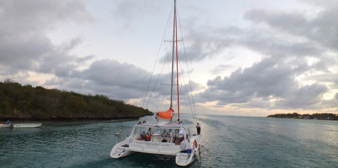 Embark for sunset cruise on catamaran